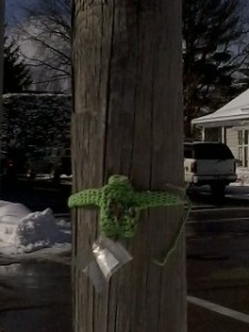 Little green sweater on a light pole.